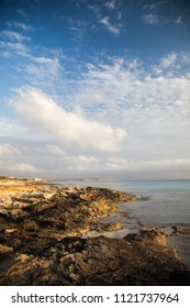 Wild landscape of the Mediterranean coast with the sea and distant mountains