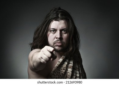 Wild man with long hair point with finger or press button on the screen