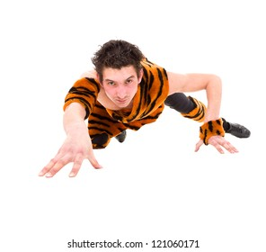 Wild man wearing a tiger skin crawls against isolated white background