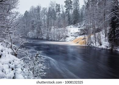 Wild Morrum river in snowy winter, Sweden