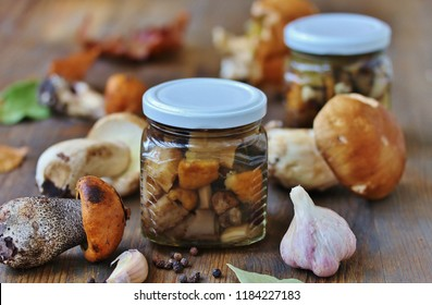 wild mushrooms Boletus edulis and cap boletus in a jar. canned marinated pickled  forest mushrooms - aspen, boletus and cep