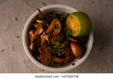 wild mushrooms with garlic and calamansi citrus fruit
