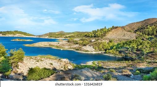 Wild nature around reservoir of Gadoura Dam on Rhodes Island - PANORAMA (Rhodes, Greece)