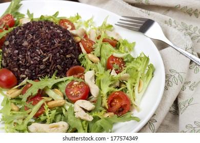 Wild rice and chicken arugula salad
