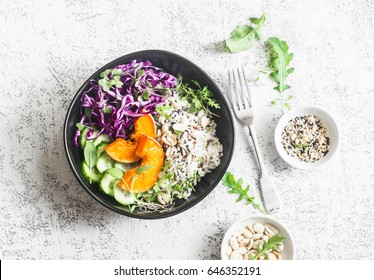 Wild rice, roasted pumpkin, red cabbage buddha bowl. Vegetarian food concept. On a light background, top view
