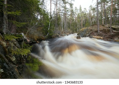Wild river in springtime with a lot of meltwater photograped with long exposure