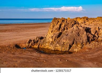 Wild rocky beach in Brittany on Armor Coastline.