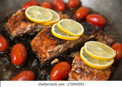 Wild Salmon Fillets on Skillet with Cherry Tomatoes