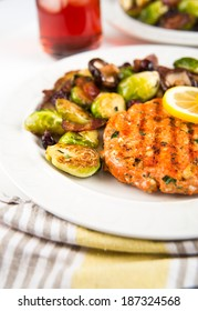 Wild Salmon Patty Served with Brussels Sprouts and Mushroom Hash