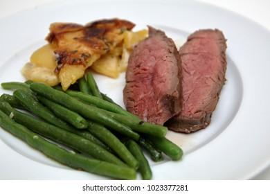 wild salmon with potato gratin and broccoli