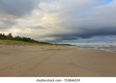 Wild sandy beach under cloudy sky of sunset in summer, Palanga Resort, Lithuania, Europe