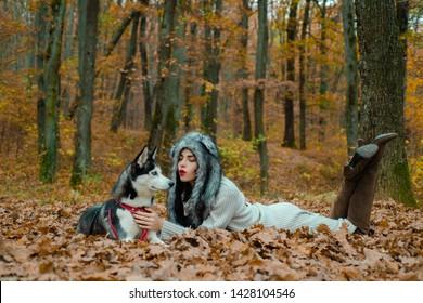 Wild in soul. Siberian husky favorite pet. Animal husbandry. Girl pretty stylish woman walking with husky dog autumn forest. Pedigree dog concept. Girl enjoy walk with husky dog. Unconditional love.