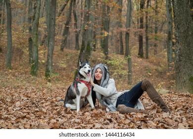 Wild in soul. Unconditional love. Siberian husky favorite pet. Animal husbandry. Girl pretty stylish woman walking with husky dog autumn forest. Pedigree dog concept. Girl enjoy walk with husky dog.