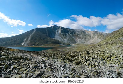 wild sunny landscape of mountains and lake, Ural, Russia
