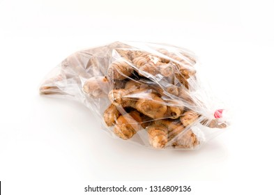 Wild Turmeric (Curcuma aromatica salisb) in Plastic bag on white background