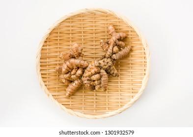 Wild Turmeric (Curcuma aromatica salisb)on bamboo colander on white background