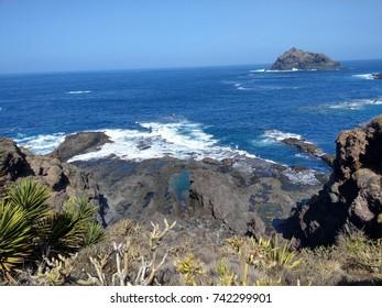 wild voulcanic beach in tenerife rocky with stones
