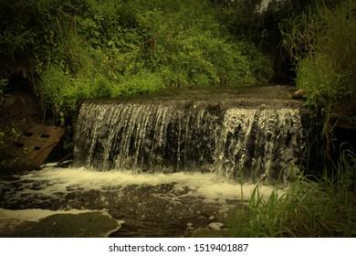 Wild waterfall (water and nature)
