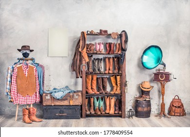 Wild West accessories. Retro leather boots, hats, clothes, holsters, old gramophone, barrel, suitcases and poster blank on a wall. Cowboy store interior conceptual design. Vintage style filtered photo - Shutterstock ID 1778409554