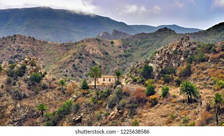 """The wild west of the Canary Island """"La Gomera"""", with mountains, red soil, crippled trees and lonely finca."""