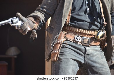 wild west cowboy with two guns and leather holsters