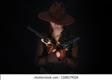 wild west girl with revolvers gun on black background