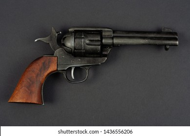 wild west revolver - colt single action army on black background