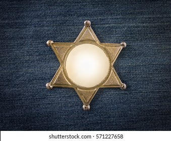 Wild West Sheriff badge on denim background