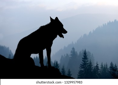 Wilderness landscape with wolf silhouette on mountains background