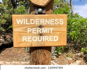 Wilderness Permit Required sign on wooden post
