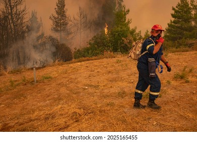 Wildfires in Evia island, Greece near Galatsonas village, burn for 6th day while firefighters sided by local volunteers and European supported forces are fighting to extinguish the fire. August 9,2021