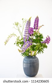Wildflower bouquet isolated on white background, Lupine flower in vase