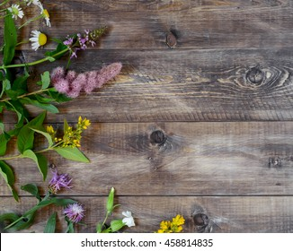 Wildflowers on a wooden background