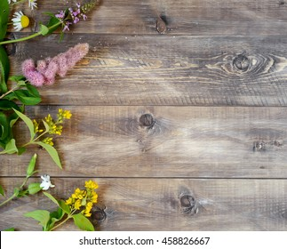 Wildflowers on a wooden background. Top view
