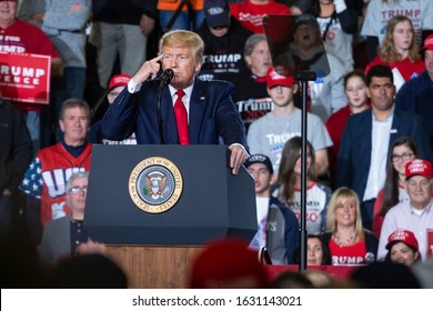 """Wildwood, New Jersey - January 28, 2020: President Donald J. Trump points to his head and speaks to a large crowd at the """"Keep America Great"""" rally held at the Wildwoods Convention Center."""