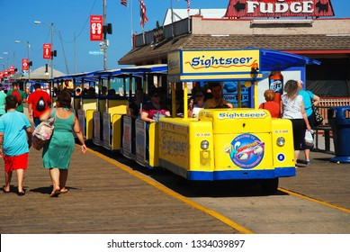 Wildwood, NJ, USA August 24, 2013 The tram car takes tourists for a ride on the Wildwood, New Jersey Boardwalk during the summer