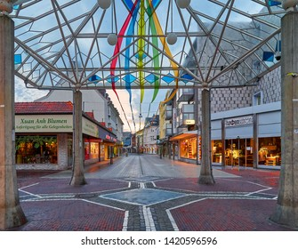 Wilhelmshaven, Germany - June 07, 2019: glass pavillon in the pedestrian zone at dawn decorated the colorful bands