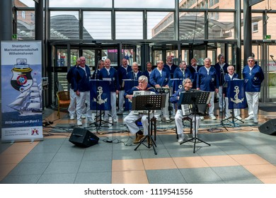 Wilhelmshaven, Germany - May 12, 2018: The Chanty chor performs songs in the Nordseepassage.
