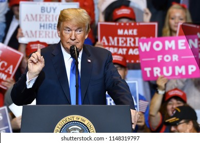 "WILKES-BARRE, PA - AUGUST 2, 2018: President Donald Trump with the ""pointing index finger"" gesture as he speaks at a campaign rally for Congressman Lou Barletta."