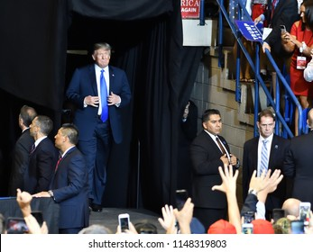 WILKES-BARRE, PA - AUGUST 2, 2018: President Donald Trump arrives on stage at a campaign rally for Congressman Lou Barletta.