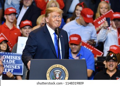 WILKES-BARRE, PA - AUGUST 2, 2018: President Trump gestures with a smile to the audience during a campaign rally for Congressman Lou Barletta.