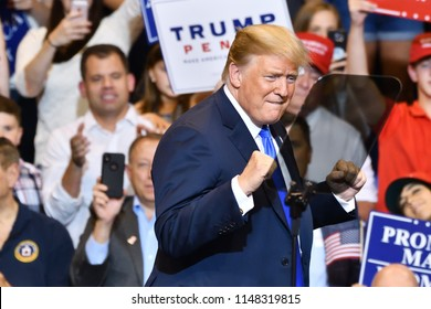 "WILKES-BARRE, PA - AUGUST 2, 2018: President Donald Trump gives a ""double fist pump"" gesture during a campaign rally for Congressman Lou Barletta."