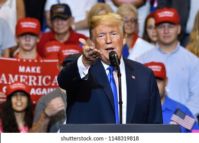 "WILKES-BARRE, PA - AUGUST 2, 2018: President Donald Trump gestures to the media as he discusses ""fake news"" at a campaign rally for Congressman Lou Barletta."