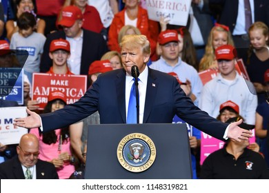 "WILKES-BARRE, PA - AUGUST 2, 2018: President Donald Trump gestures ""can you believe this"" with wide open hands at a campaign rally for Congressman Lou Barletta."