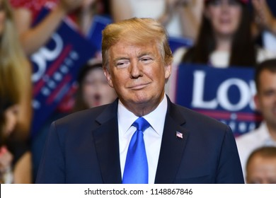 WILKES-BARRE, PA - AUGUST 2, 2018: President Donald Trump stands on stage looking to his right as Congressman Lou Barletta delivers a campaign speech.