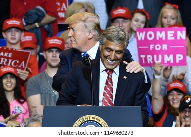 WILKES-BARRE, PA - AUGUST 2, 2018: President Trump embraces Congressman Lou Barletta at a campaign rally for his run for Senate.