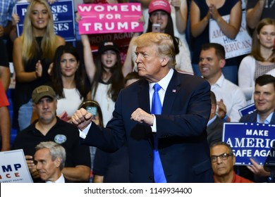 WILKES-BARRE, PA - AUGUST 2, 2018: President Trump prepares to exit the stage after delivering a speech at a campaign rally.