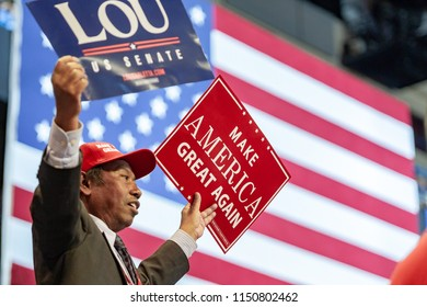 "WILKES-BARRE, PA - AUGUST 2, 2018: A Lou Barletta and ""Make America Great Again"" signs are held up by a fan during the ""Make America Great Again"" rally held at the Mohegan Sun Arena."