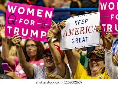 "WILKES-BARRE, PA - AUGUST 2, 2018: A group of Trump supporters display their ""Women For Trump"" and ""Keep America Great"" signs during the ""Make America Great Again"" rally held at the Mohegan Sun Arena."
