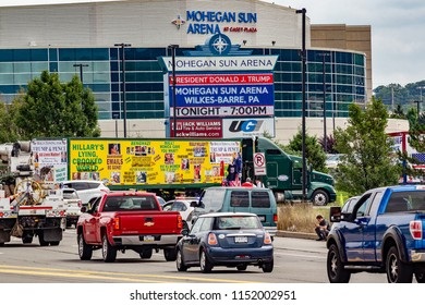 """WILKES-BARRE, PA - AUGUST 2, 2018: A Bolus Freight trailer awaits entry to the """"Make America Great Again"""" rally. Turned away, owner Bob Bolus has sued the Mohegan Sun Arena and the Secret Service."""